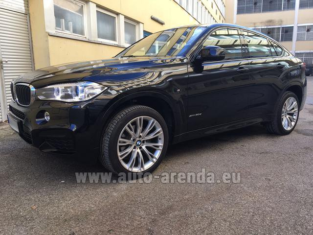 Hire and delivery to the München airport the car BMW X6 3.0d xDrive High Executive M Sport