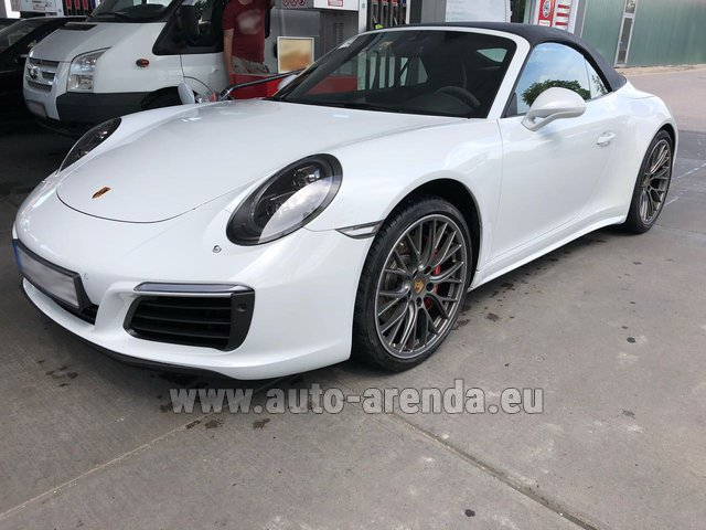 Hire and delivery to Rottach-Egern the car Porsche 911 Carrera Cabrio White